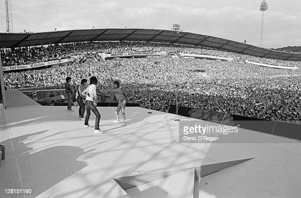 The Rolling Stones performing at the Ullevi stadium, Gothenburg, Sweden, June 1982. Left to right: Bill Wyman, Keith Richards, Ronnie Wood and Mick...