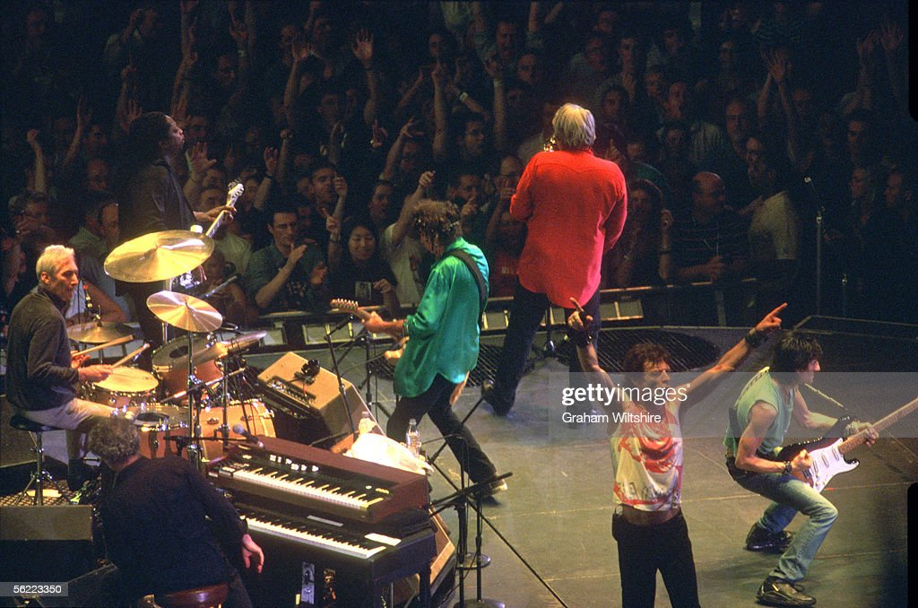 The Rolling Stones performing on stage at Wembley Arena, London, 15th September 2003. Left to right: Charlie Watts, Daryl Jones (bass), Chuck Leavall (keyboards), Keith Richards, Bobby Keyes (saxophone), Mick Jagger and Ronnie Wood.