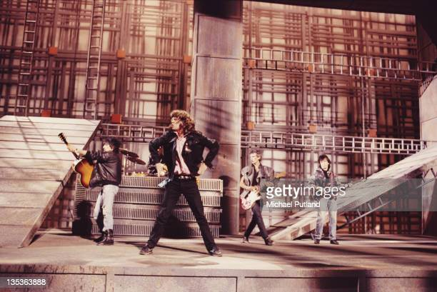 The Rolling Stones performing on the set of the music video for 'One Hit ' England May 1986 Left to right Ronnie Wood Mick Jagger Keith Richards and...