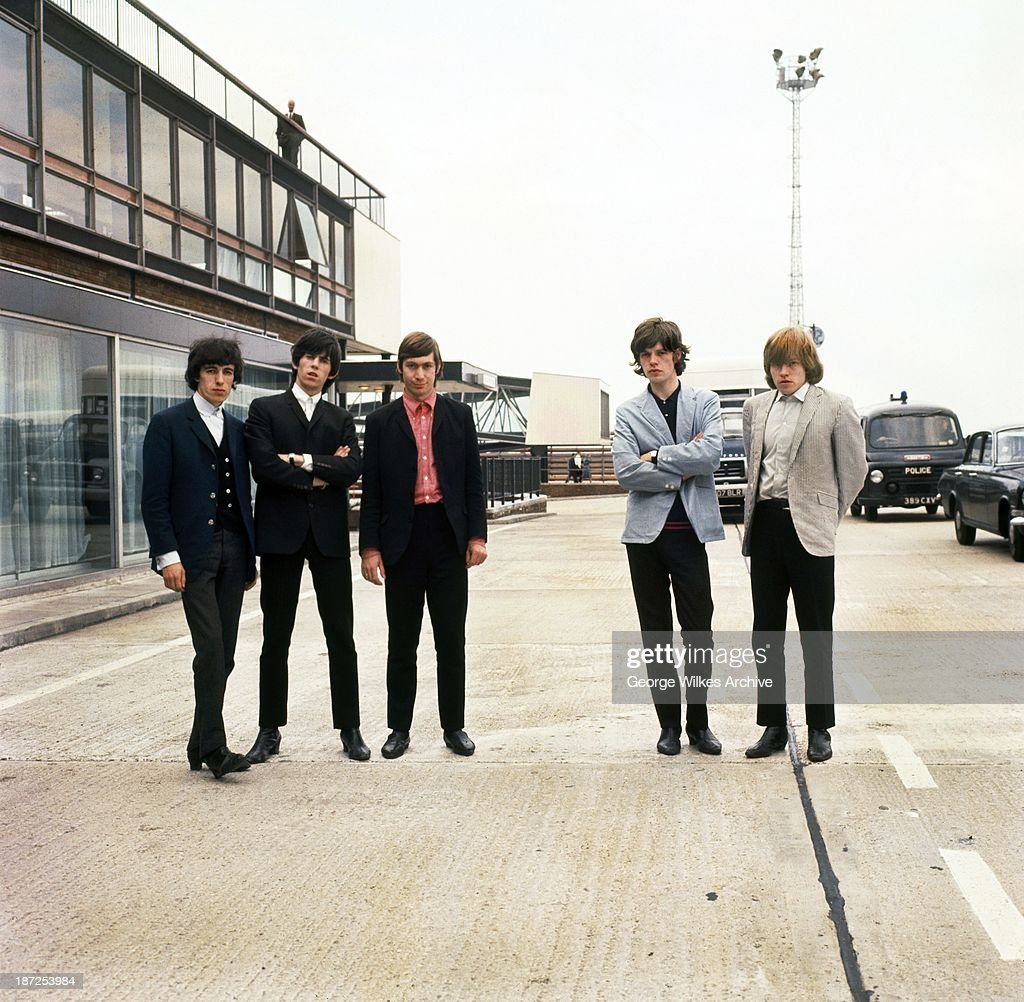 The Rolling Stones photographed at an airport. The band formed in London in 1962 were in the vanguard of the British rock 60's and 70's revolution. Right of photo is lead guitarist Brian Jones who was found motionless at the bottom of his swimming pool at his East Sussex farm around midnight on the night of 2–3 July 1969. Doctors pronounced him dead at the scene.
