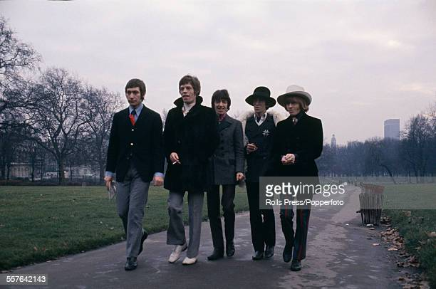 The Rolling Stones pictured walking together for a press call in Green Park London on 11th January 1967 From left to right Charlie Watts Mick Jagger...