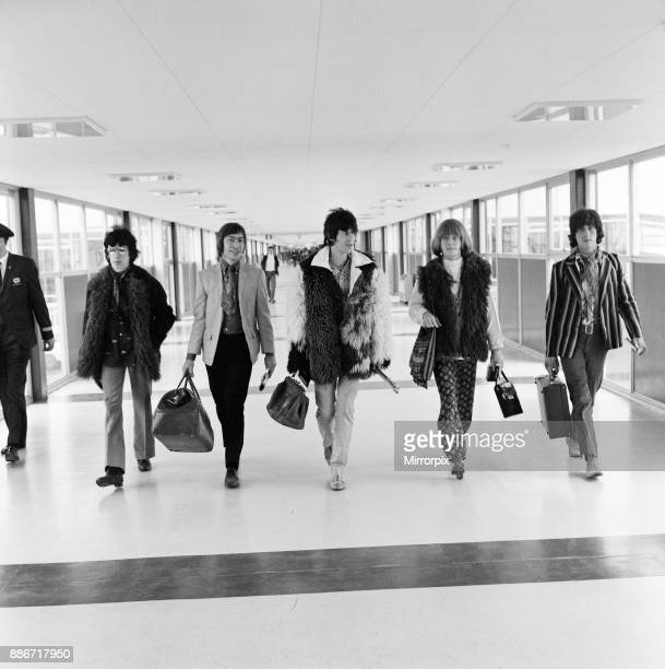 The Rolling Stones pop group, minus lead singer Mick Jagger, pictured at London's Heathrow airport en route to the USA. Mick Jagger and Marianne...