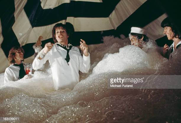 MERCHANDISING** The Rolling Stones pose during the production of their music video for 'It's Only Rock 'n Roll ' in June 1974 in London England The...