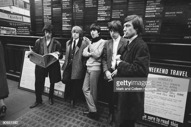 The Rolling Stones pose on Platform 14 of Victoria Station in London on their way to a gig in Brighton 11th October 1964 From left to right Bill...