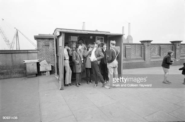 The Rolling Stones pose outside the pie stall on Battersea Bridge in London before heading off to a gig in Brighton 11th October 1964 Battersea Power...
