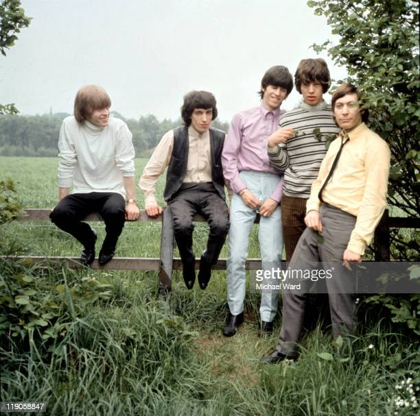 The Rolling Stones posing for a picture in the countryside Brian Jones Bill Wyman Keith Richards Mick Jagger and Charlie Watts 1964
