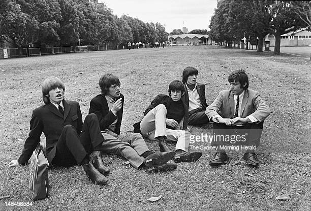 The Rolling Stones relax on the lawn before their matinee show at the Sydney Showground January 23 1965