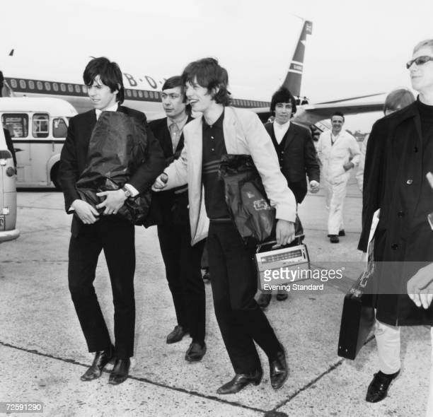 The Rolling Stones with manager Andrew Loog Oldham at London Airport for a flight to Dusseldorf before a tour of West Germany 11th September 1965...