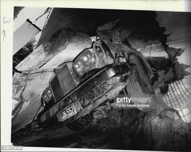 The Rolls Royce owned by Mr J Norris of College Lane Bellevue Hill hangs through the roof of a laundry inside his collapsed houseThe car with its...