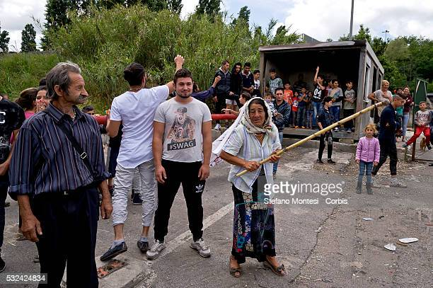 The Roma people scream insults and protests the leader of the Northern League Matteo Salvini on arrival at the camp roma camp of Via Candoni on the...