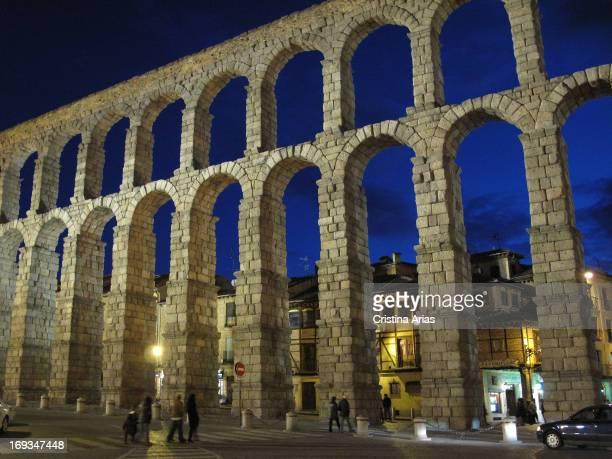 The Roman aqueduct of Segovia illuminated at night Autonomous Community of Castilla Leon Spain March 2012