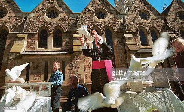 The Roman Catholic Archbishop of Adelaide Philip Wilson releases white doves with schoolchildren outside St Francis Xavier Cathedral previous to...
