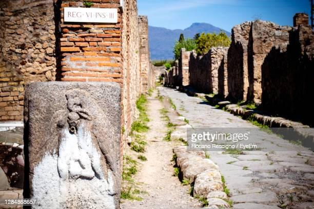 the roman city of pompeii was buried by the eruption in 79 ad of mount vesuvius - rome italy stock pictures, royalty-free photos & images