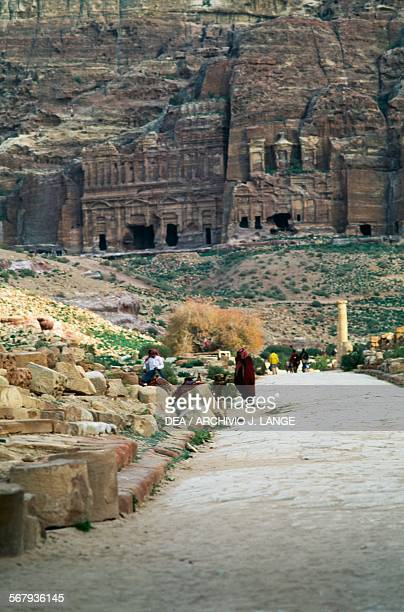 The Roman colonnade street with the wall containing the Royal tombs in the background ancient city of Petra Jordan Nabatean civilisation 6th century...