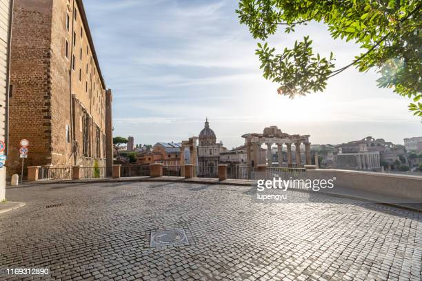 the roman forum at sunrise, rome, italy - cobblestone stock pictures, royalty-free photos & images