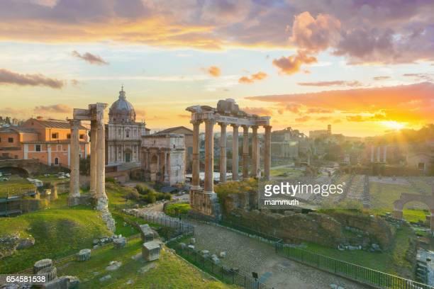 the roman forum at sunrise, rome, italy - roma stock photos and pictures