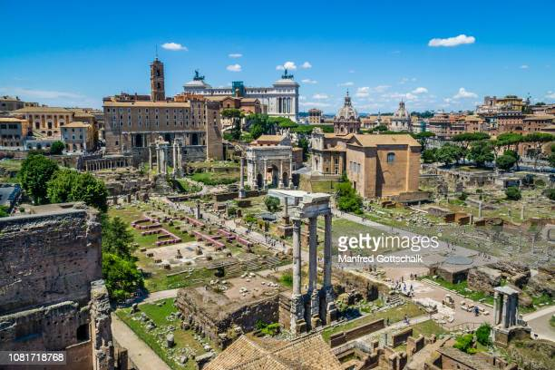 the roman forum from palatine hill with view of the central square area and the remaining corinthian columns of the temple of castor and pollux in the foreground, rome, italy, june 28, 2018 - roman forum stock pictures, royalty-free photos & images