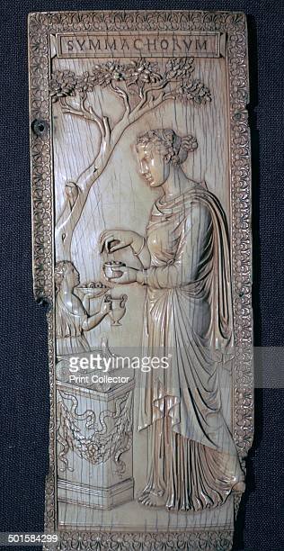 The Roman ivory Symmacki Diptych showing an offering at an altar 4th century
