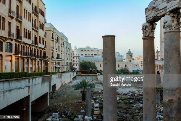 The roman ruins in the center of a city