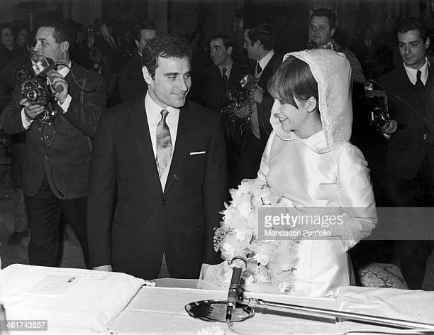 The Roman singer Edoardo Vianello and the Dalmatianborn singer Wilma Goich wearing the traditional bridal gown with embroided cap gloves and bouquet...