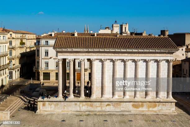 the roman temple named maison carree, nimes, gard,languedoc roussillon, france - nimes stock pictures, royalty-free photos & images
