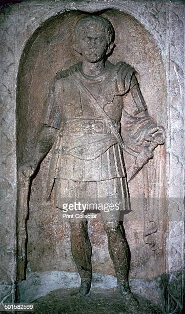 The Roman tombstone of Marcus Favonius Facilis Centurion of the 20th legion of the Pollonian tribe at Colchester Museum He has a sword dagger and...