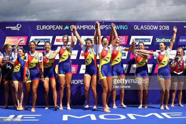 The Romania team celebrate winning gold in the Women's Eight during the rowing on Day Three of the European Championships Glasgow 2018 at Strathclyde...