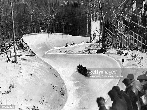 The Romanian bobsled team takes a curve on its final run during Olympic games at Mt von Hoevenberg in Lake Placid