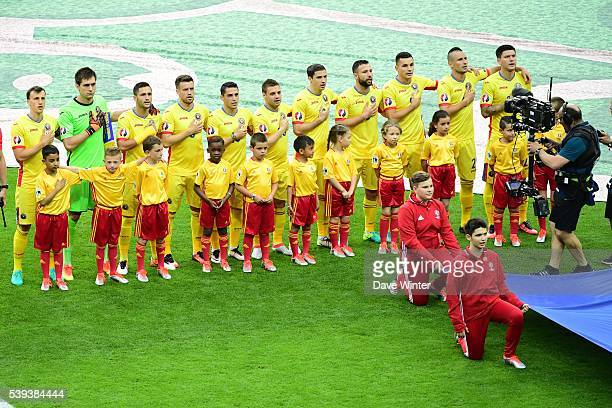 The Romanian team during their national anthem before the GroupA preliminary round match between France and Romania at Stade de France on June 10...