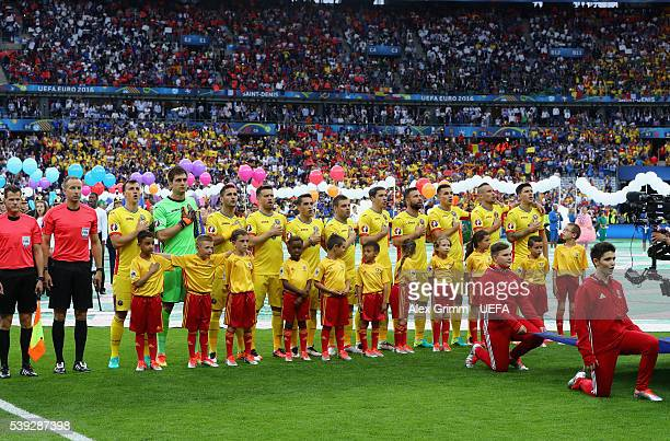 The Romanian team sing their national anthem prior to kickoff during the UEFA Euro 2016 Group A match between France and Romania at Stade de France...