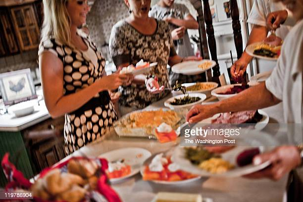 The Romney family fills their plates for Sunday lunch after church service in Colonia Juarez Mexico in July 2011 United States Presidential candidate...