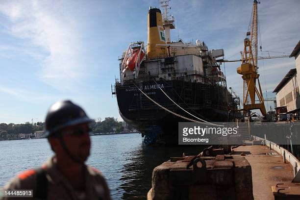 The Romulo Almeida a Petroleo Brasileiro SA oil tanker under construction sits at a dock at the Maua SA shipyard in Niteroi Brazil on Thursday May 10...