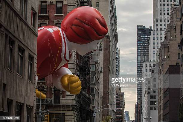 The Ronald McDonald balloon floats between the buildings at the 90th annual Macy's Thanksgiving Day Parade in Six Avenue on November 24 2016 in New...