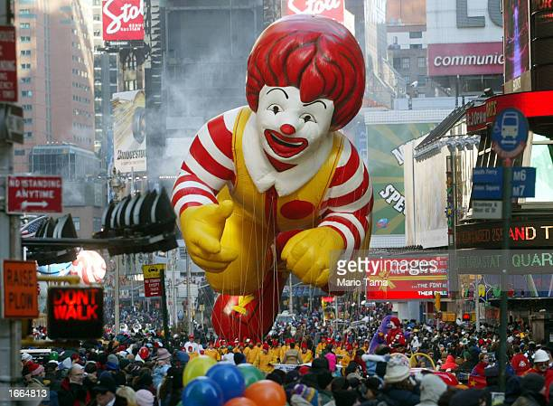 The Ronald McDonald balloon makes his way through Times Square during the 76th annual Macy's Thanksgiving Day Parade November 28 2002 in New York...