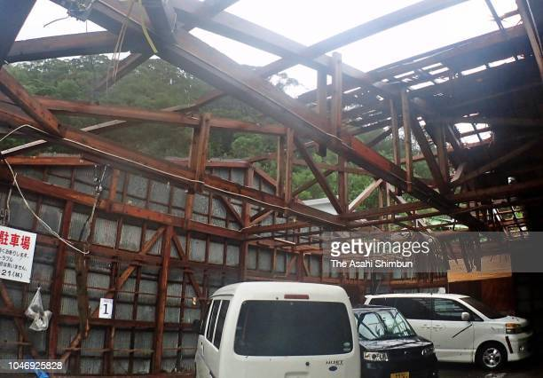 The roof of a car park is ripped off by strong wind as powerful Typhoon Trami hit on September 30 2018 in Amami Kagoshima Japan The typhoon is...