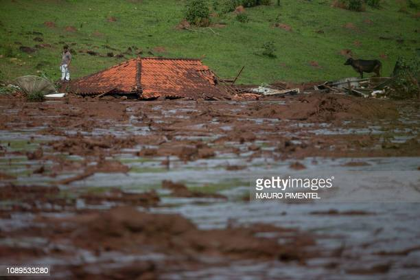 TOPSHOT The roof of a house is seen in the mudhit area a day after the collapse of a dam at an ironore mine belonging to Brazil's giant mining...