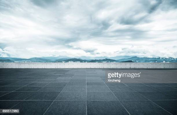 the roof parking lot - horizon over land stock photos and pictures