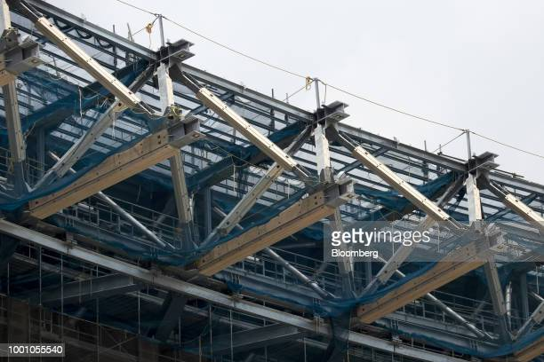 The roof structure of the New National Stadium the main venue for the Tokyo 2020 Olympic and Paralympic Games is seen at the construction site in...