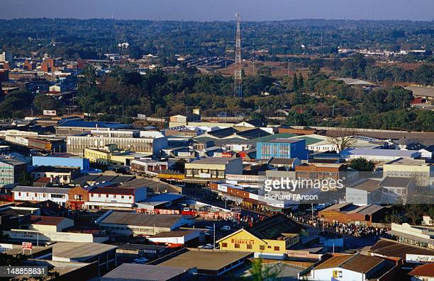 The rooftops of the suburbs surrounding a communications tower; a view of Harare from Kpoje