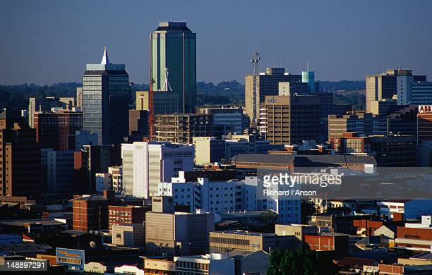 The rooftops of the suburbs surrounding the city high-rises; a view of Harare from Kpoje