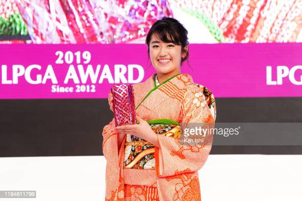 The Rookie of The Year Mone Inami of Japan poses with the trophy during the LPGA Awards on December 18 2019 in Tokyo Japan