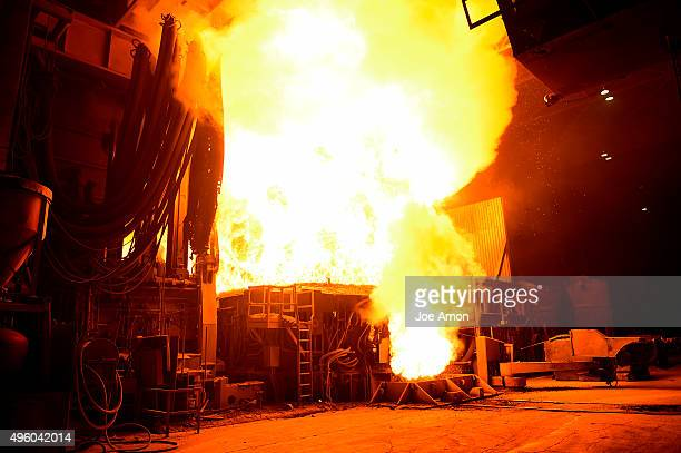 The room is filled with flame and huge concussions as 130 tons of scrap charged material are heated by electric arc in the huge Electric arc furnace...
