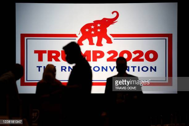 The room is set and delegates begin to arrive for the first day of the Republican National Convention meeting in the Richardson Ballroom, Charlotte...