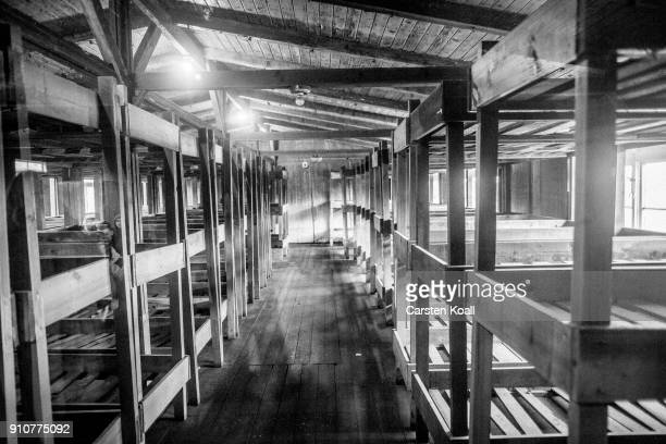 The room with bunk beds once used by prisoners in a barracks at the Sachsenhausen concentration camp memorial on January 25 2018 in Oranienburg...