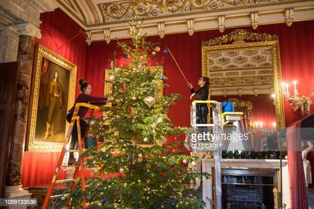 The rooms of Chatsworth House are decorated for their Christmas season as various fairy tale scenes in the theme of 'Once Upon a Time' during a...