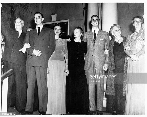 The Roosevelt family including FDR son Franklin Jr daughter Anna [] John's wife Ann son John Eleanor's mother [] and Eleanor at Hyde Park [possibly...
