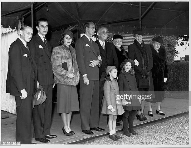 The Roosevelt family on Christmas Day just before heading out to church services from the South Lawn of the White House From left to right are...