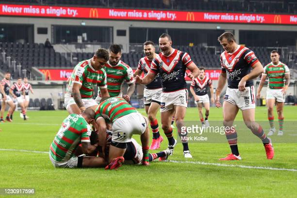 The Roosters celebrate a try scored by Daniel Tupou of the Roosters during the round three NRL match between the Sydney Roosters and the South Sydney...