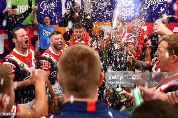 The Roosters celebrate in the changerooms after winning the 2018 NRL Grand Final match between the Melbourne Storm and the Sydney Roosters at ANZ...
