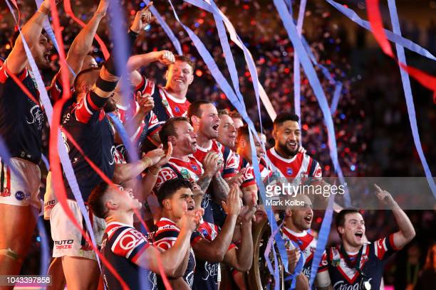 The Roosters celebrate victory during the presentation ceremony after the 2018 NRL Grand Final match between the Melbourne Storm and the Sydney...